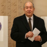 Armenian President Armen Sarkissian votes during an early parliamentary election in Yerevan